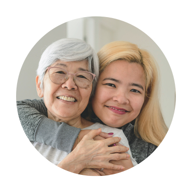 Image of granddaughter and grandmother smiling and hugging
