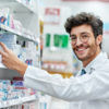 Image: Smiling pharmacist reaching for medication