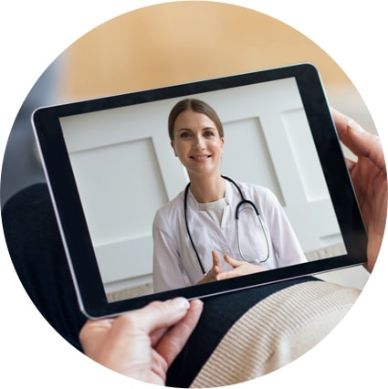 Electronic tablet displaying virtual visit with doctor