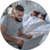 Circle image of man interacting on laptop