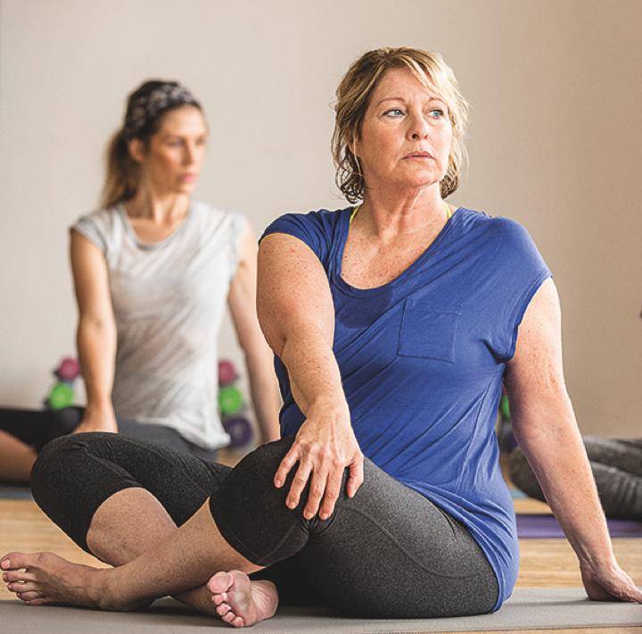 2 women doing yoga
