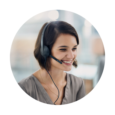 Image of smiling woman in a gray blouse talking on a headset