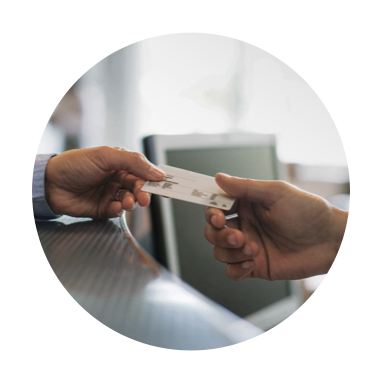 Image of member handing ID card to provider office staff