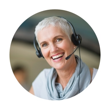 Image of older woman smiling with headset