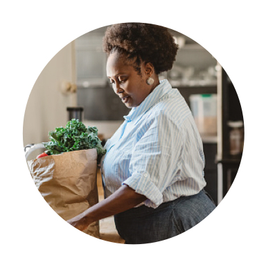 image of woman unloading bag of groceries