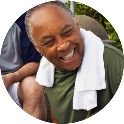 Older man with towel over shoulders laughing