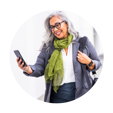 Woman smiling at cell phone